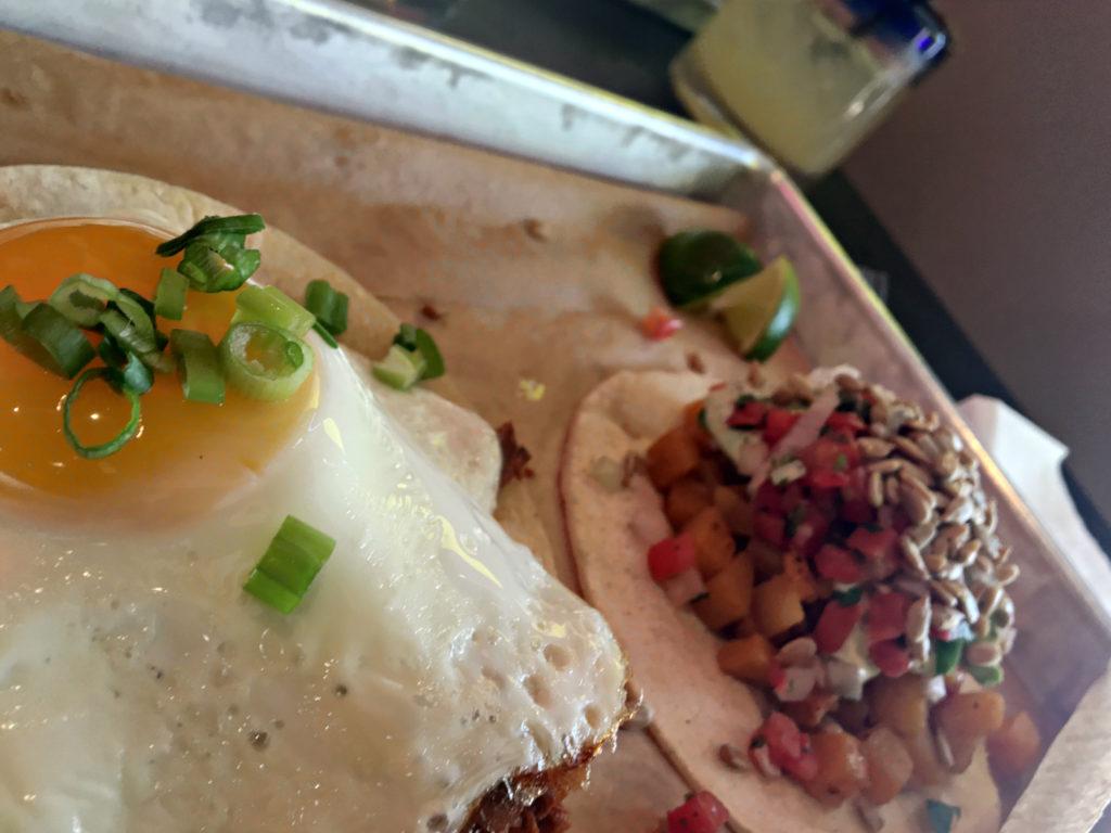 Foreground: Chorizo & Egg Taco